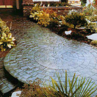 Slate Cobblestone Circle with London Cobblestone - custom concrete Calgary stamped concrete textures, designs and patterns